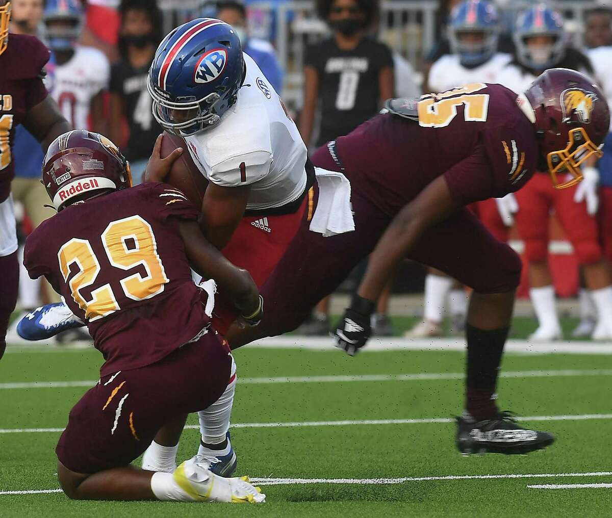 Beaumont United's Decarlos Andersonn tackles West Brook's Bryce Anderson during the season opening Alumni Bowl game Friday at BISD Memorial Stadium. Photo made Friday, August 27, 2021 Kim Brent/The Enterprise