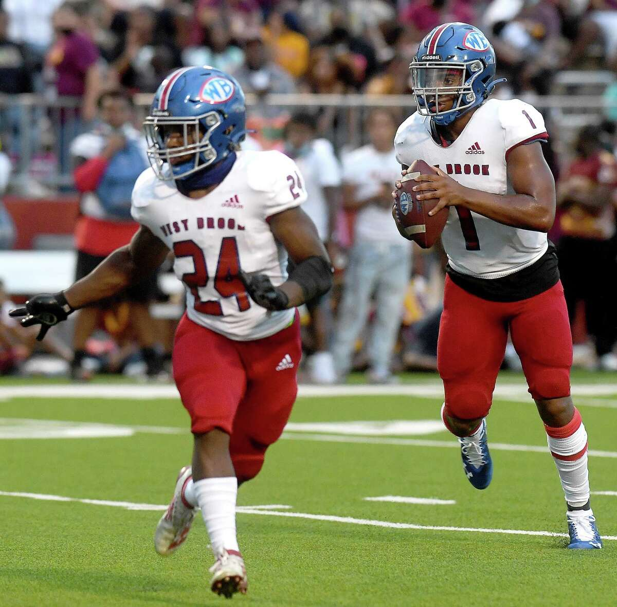 West Brook's Bryce Anderson looks forran open player against Beaumont United during the season opening Alumni Bowl game Friday at BISD Memorial Stadium. Photo made Friday, August 27, 2021 Kim Brent/The Enterprise