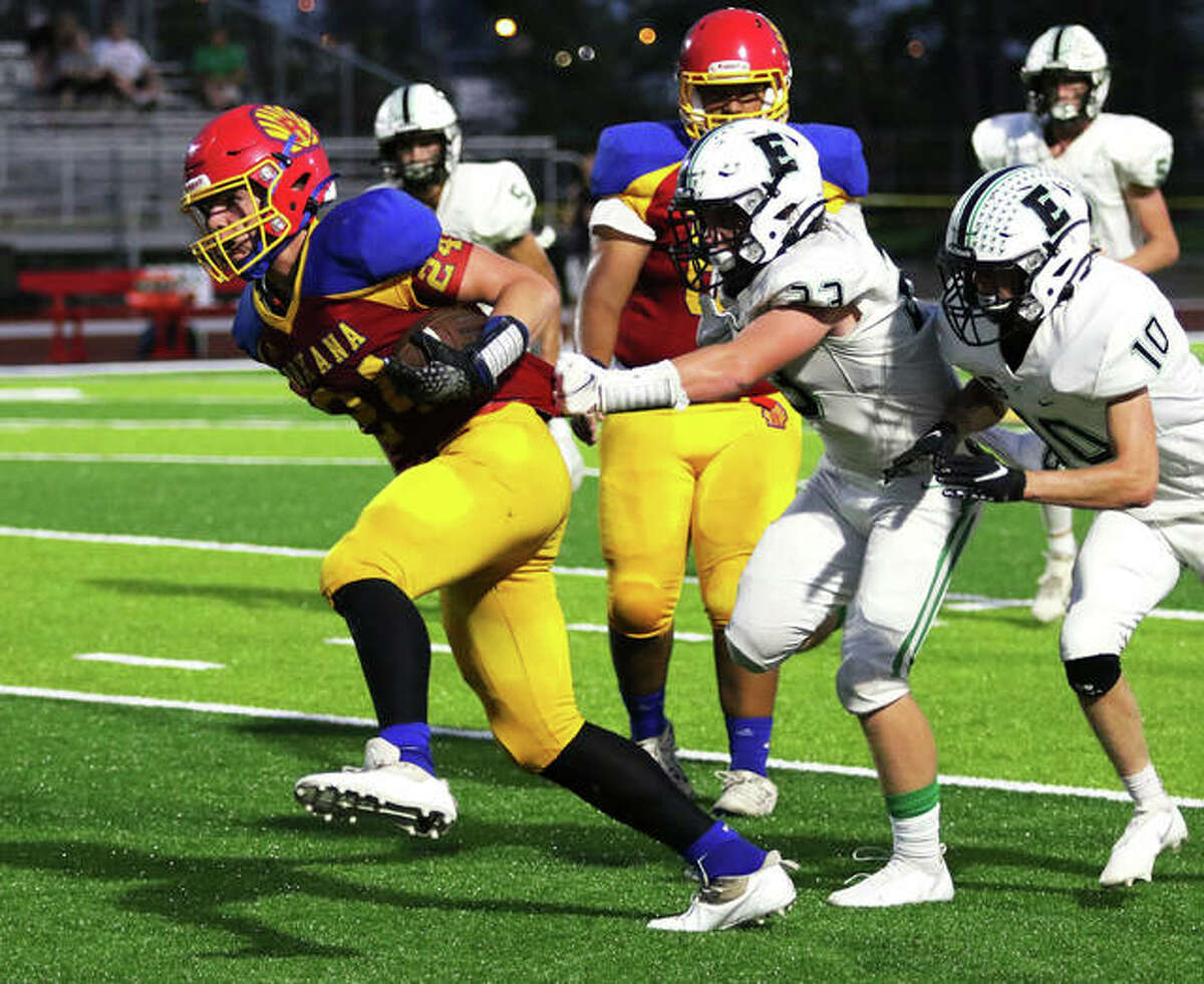 Roxana running back Evan Wells (left) breaks loose from Eureka's Mason Boles and Colin Short (10) for a big gain in the first half Friday night at Raich Field in Roxana. Wells, a sophomore, rushed for 147 yards on 18 carries in the Shells' 49-20 loss.