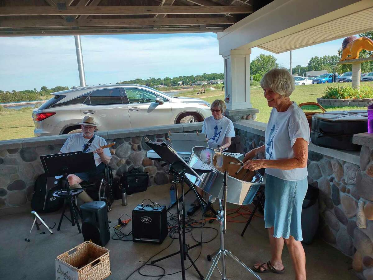 The Lighthouse Trioentertained at the Senior Center's annual summer picnic on Monday. The trio are (from left) Chuck Patton on guitar, Cheryl Ooten on keyboard and Linda Browne on steel drum. (Courtesy Photo)