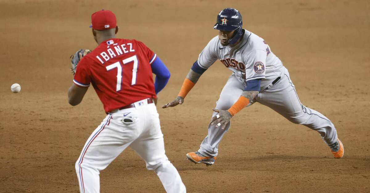 Martin Maldonado #15 of the Houston Astros runs to third base as Andy Ibanez #77 of the Texas Rangers waits for the the throw during the seventh inning at Globe Life Field on August 27, 2021 in Arlington, Texas. (Photo by Ron Jenkins/Getty Images)