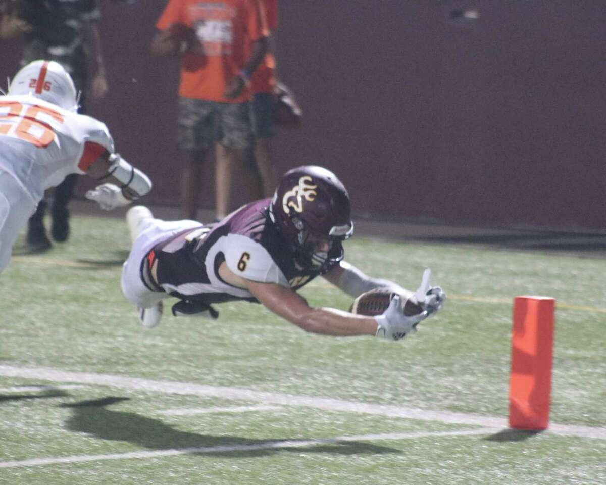 Alex Argueta dives for the corner of the end zone during first-half action Friday night. Argueta scored but it was called back because of an infraction. Argueta was still one of six Deer players to score in the rout.
