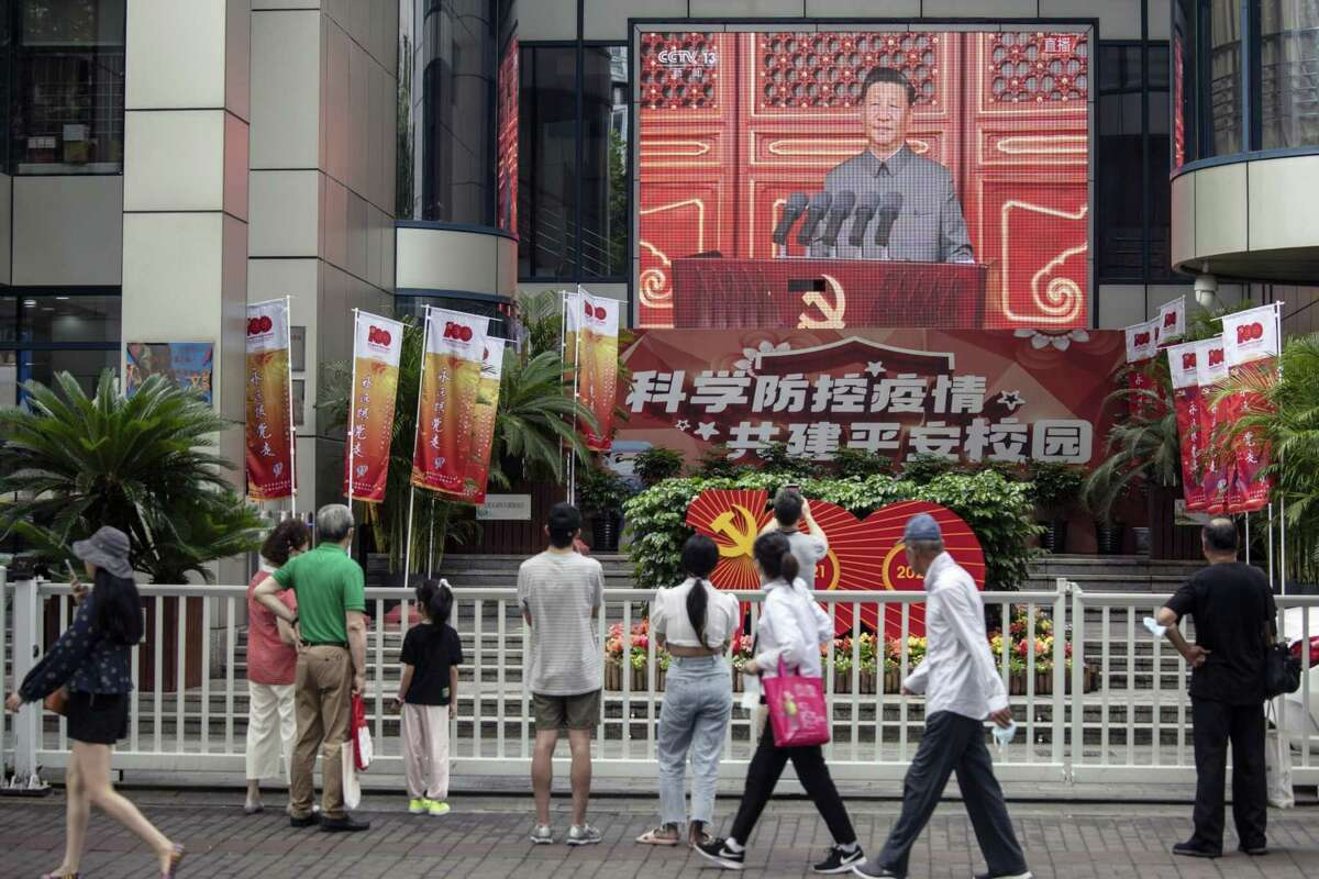 A live news broadcast of Xi Jinping at a ceremony marking the centenary of the Chinese Communiity Party, taking place at Beijing's Tiananmen Square, in Shanghai, on July 1.