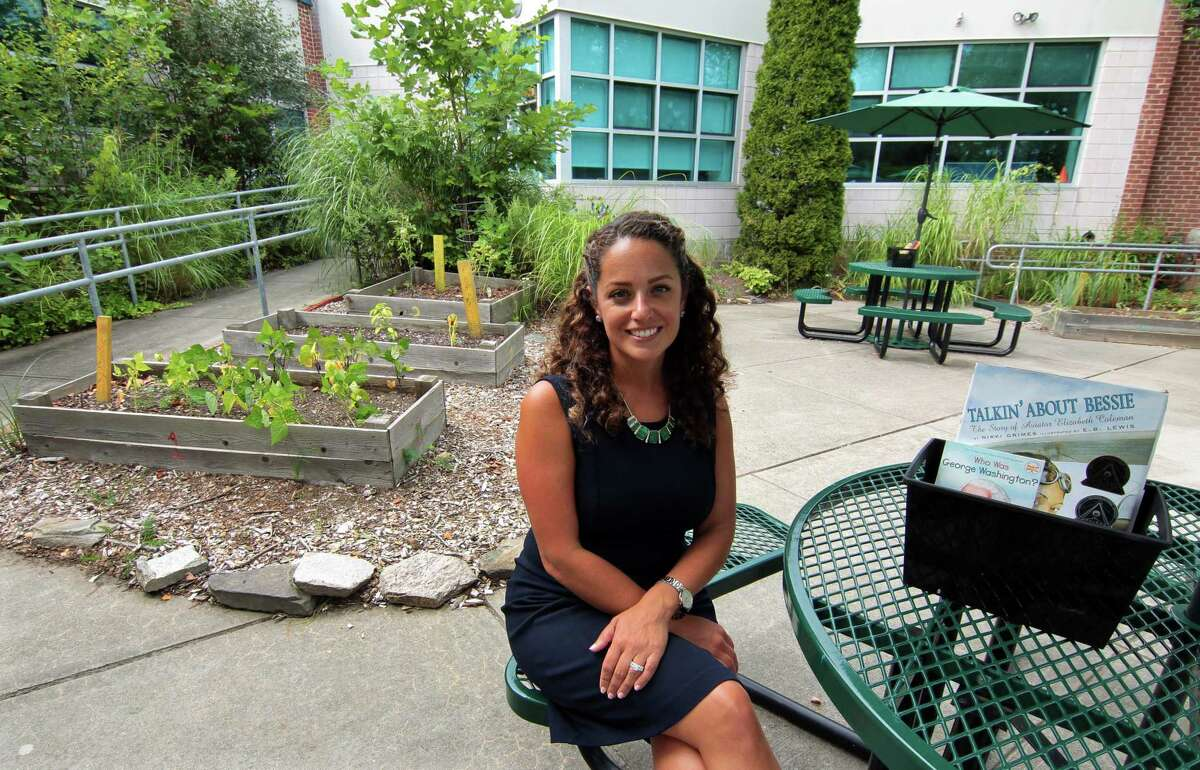 Brookside Elementary School Principal Christina Guerra poses at the school's outdoor garden in Norwalk, Conn., on Friday August 27, 2021.
