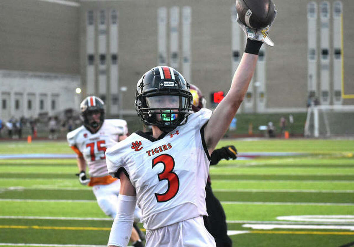 Edwardsville wide receiver Beau Brandt celebrates after catching a touchdown pass on the first play of the second quarter against De Smet on Friday in St. Louis.