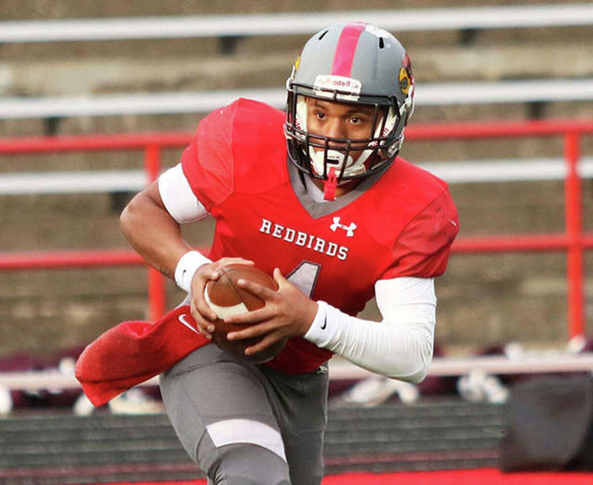 Alton's Keith Gilchrese, shown in a March 30 game last season, scored the Redbirds' lone offensive touchdown Friday night in a 22-13 defeat to Belleville Althoff in Belleville.