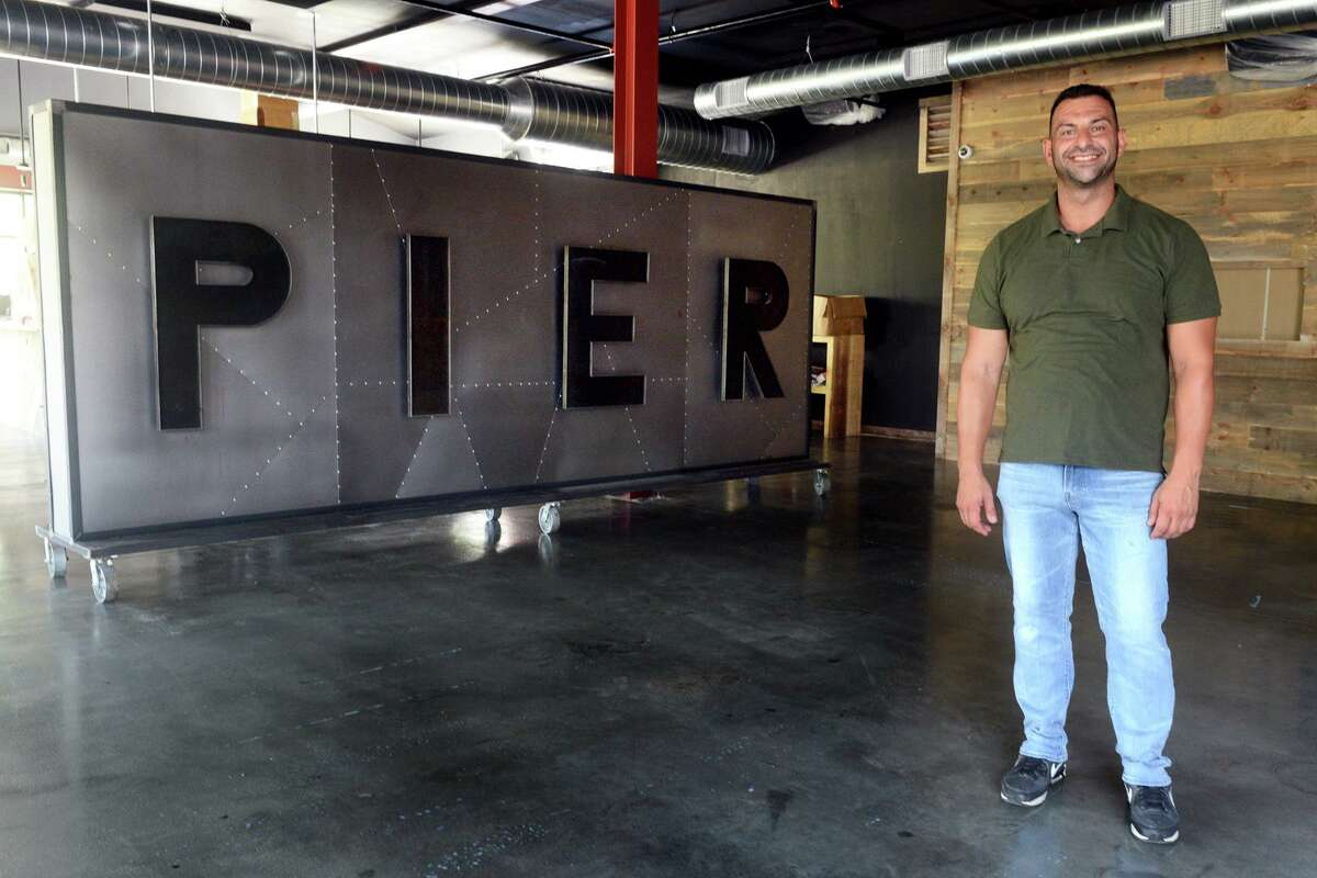 Owner Artan Ismaili stands in Pier 131 Kitchen and Bar, his new restaurant under construction in Shelton, Conn. Aug. 27, 2021.