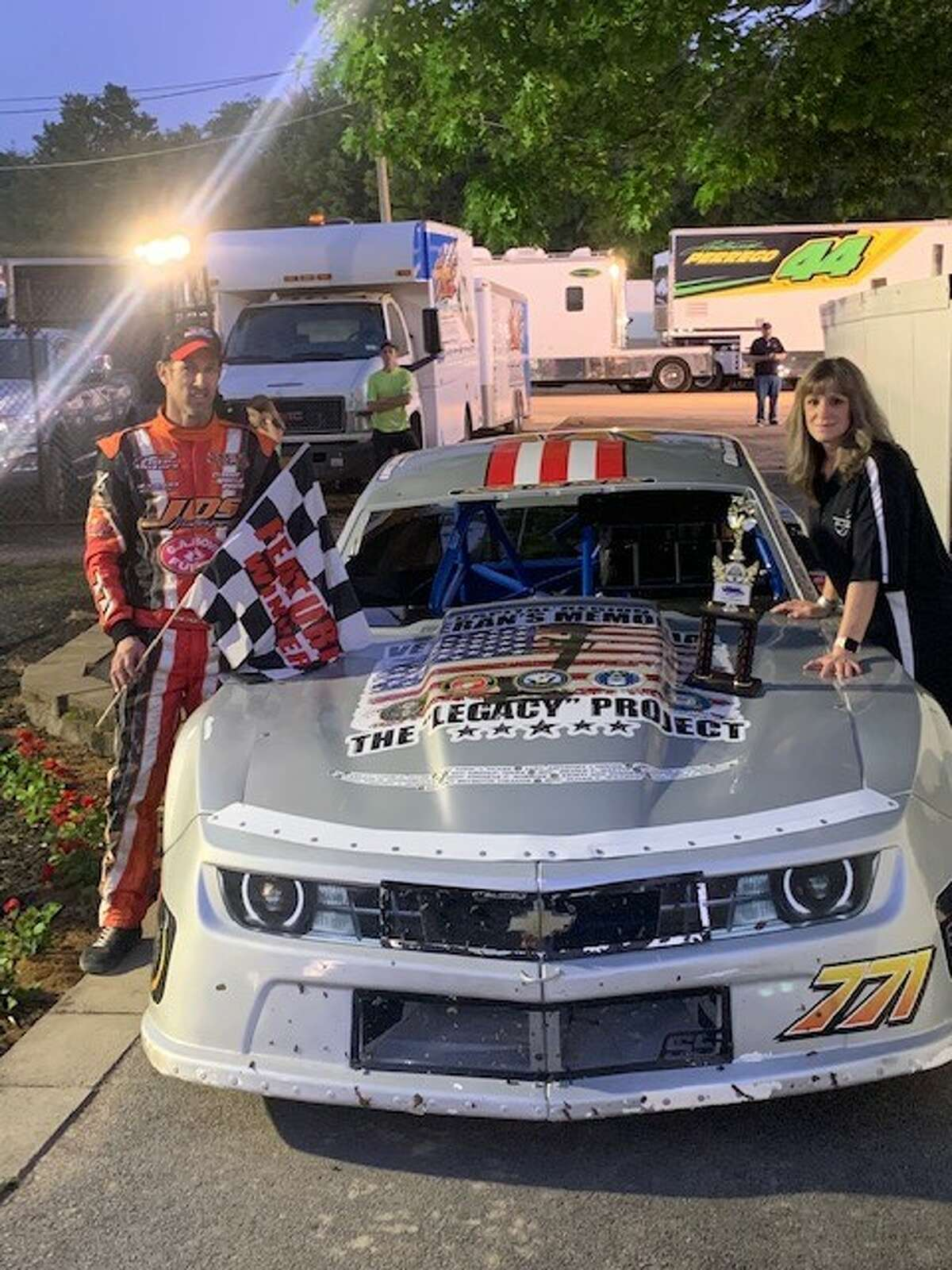 James and Justine Crowley-Duncan stand near their stockcar that promotes the Capital Region Veterans Memorial Legacy Project.