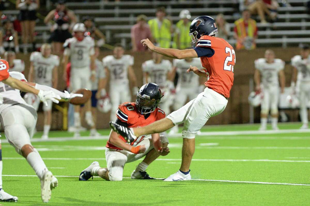 Keegan Sneedon (23) of Seven Lakes kicks a game-winning field goal in the final 3 seconds of a non-District football game between the Seven Lakes Spartans and the Memorial Mustangs on Friday, August 27, 2021 at Rhodes Stadium, Katy, TX.
