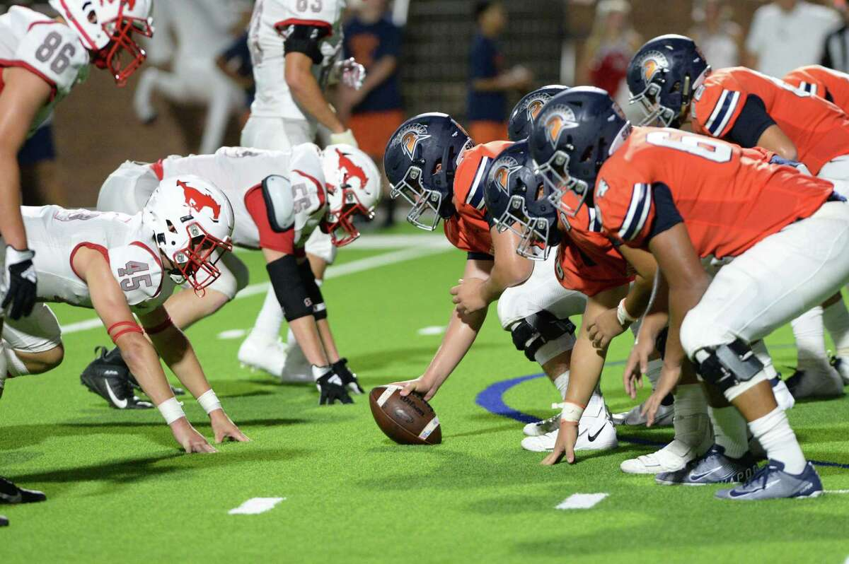 The Seven Lakes Spartans line up agains the Memorial Mustangs during the fourth quarter of a non-District football game on Friday, August 27, 2021 at Rhodes Stadium, Katy, TX.