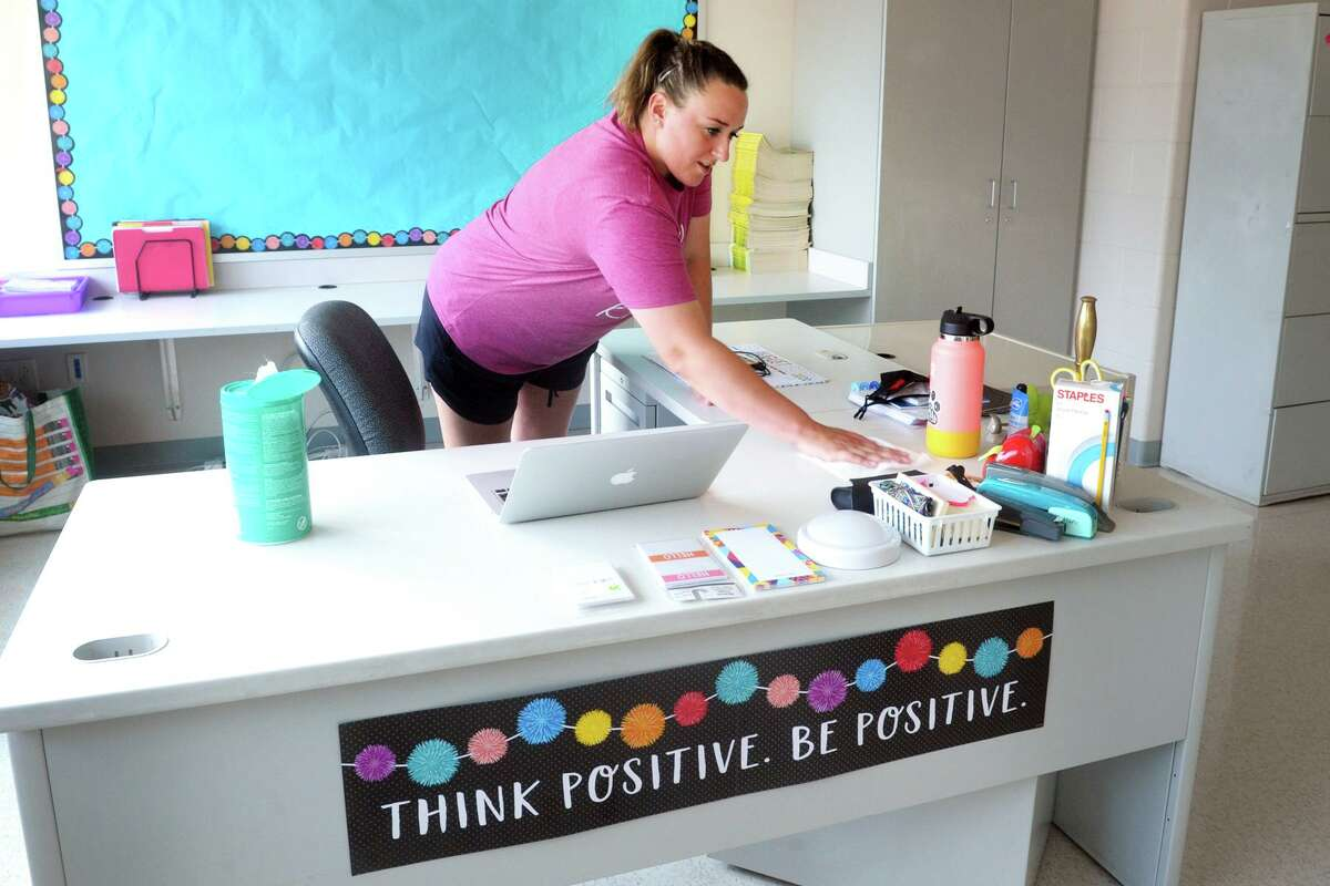 Kindergarten teacher Jessica Hattani cleaned her desk while preparing her classroom for the 2020-21 school year. As the new school year starts, most districts are finding that a projected teacher shortage because of the pandemic didn't materialize, although Bridgeport schools faces a yearly struggle to fill spots.