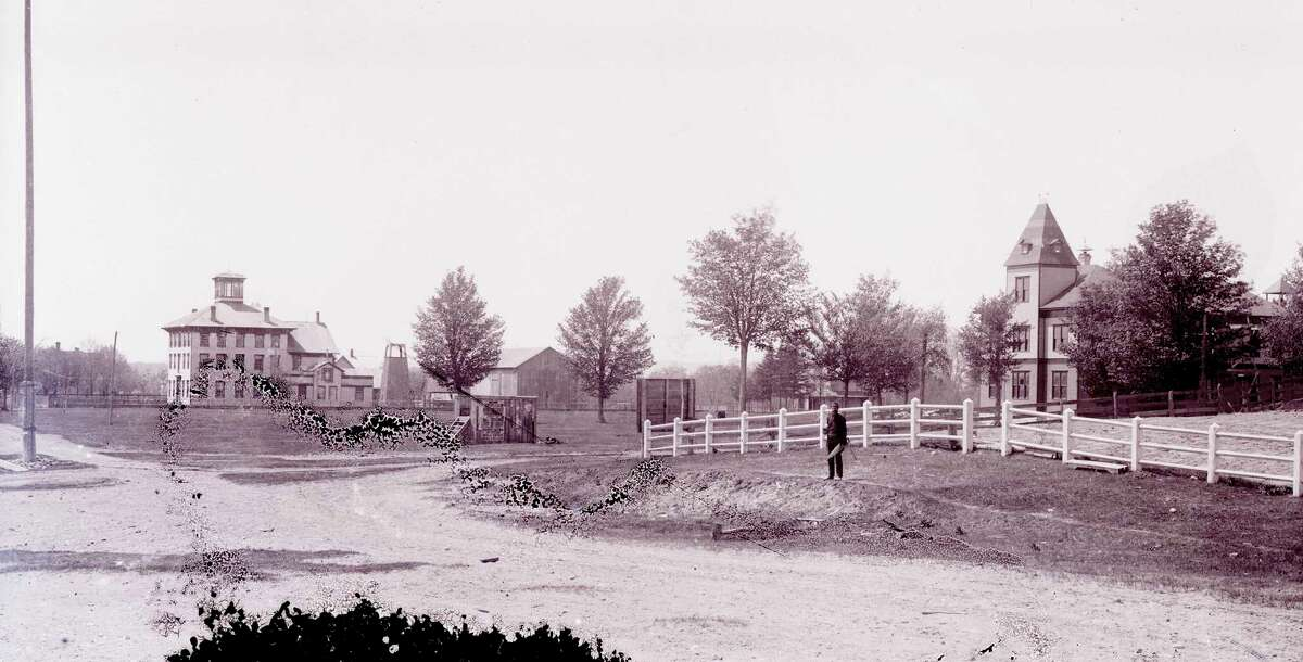 Looking southwest across the Benzonia Academy campus before 1909, showing both East Hall and Barber Hall. (Courtesy photo)