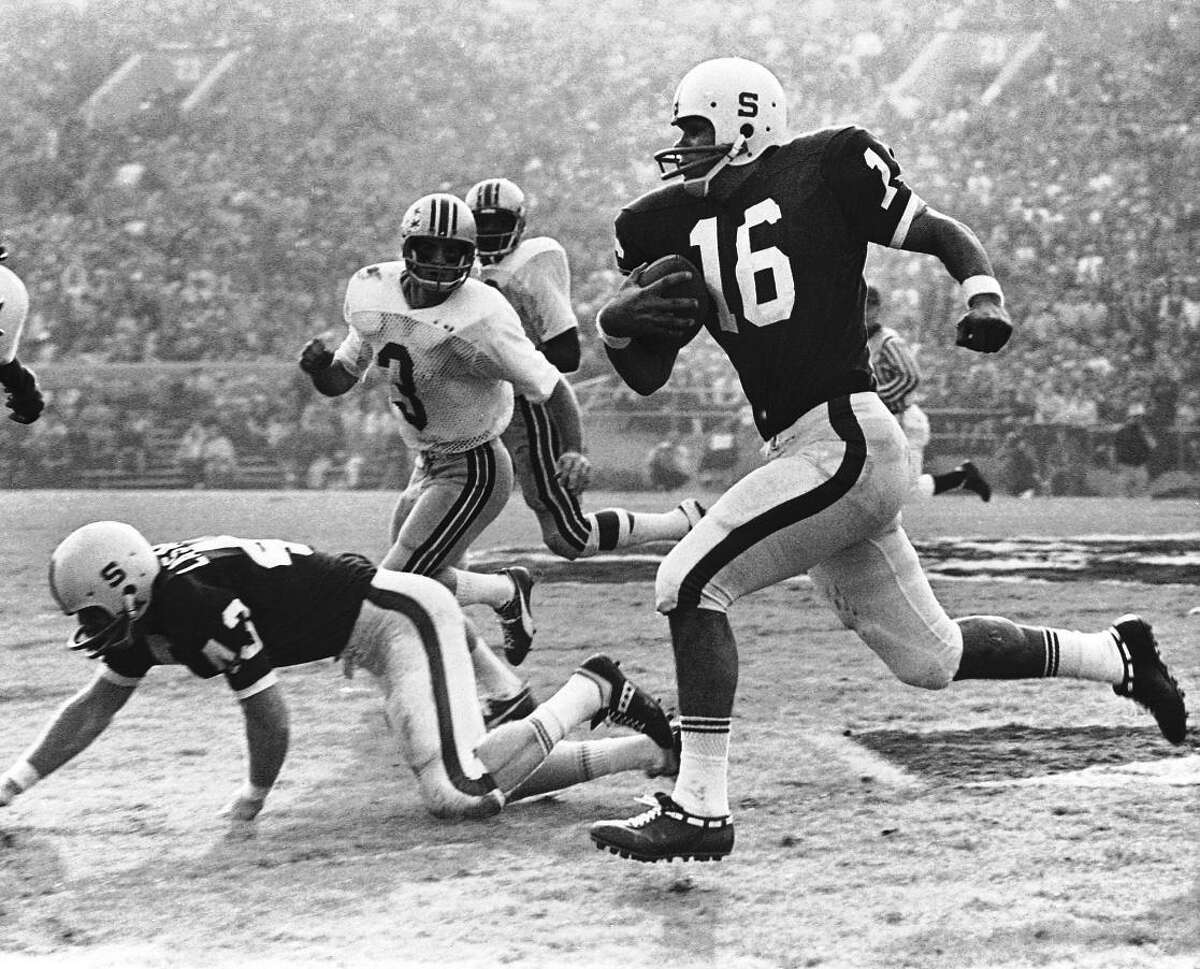Quarterback Jim Plunkett of Stanford, a hero in Rose Bowl upset victory over Ohio State, sprints through the Buckeye defense for a 22-yard gain to midfield on Jan. 2, 1971 in Pasadena, California. Beyond Stanford's Mike Lasater, on his knees, is Ohio State's, Mike Sensibaugh. Two fourth-quarter touchdowns gave Standford a 27-17 win. (AP Photo)