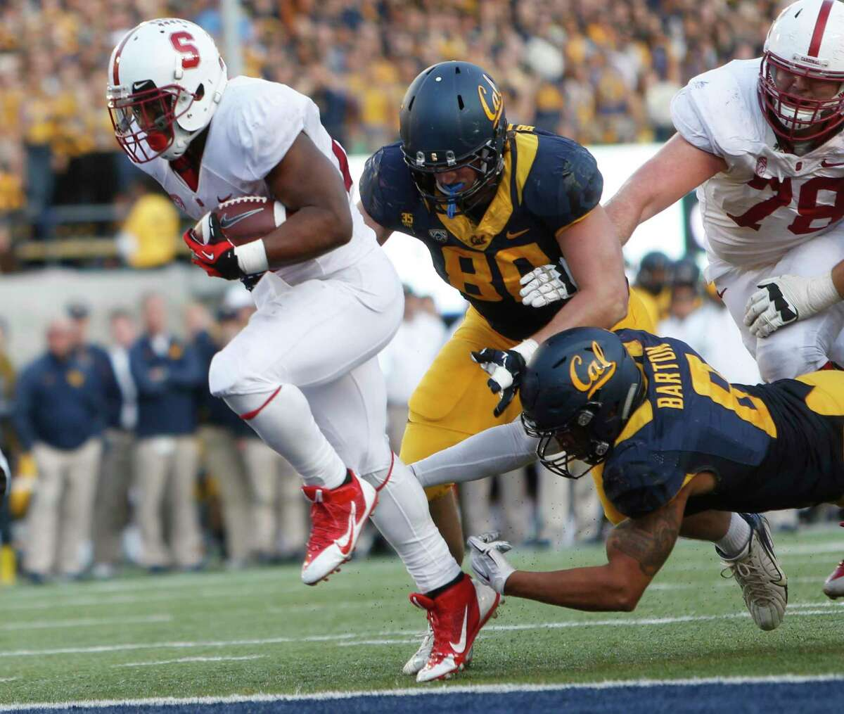 Stanford's Remound Wright scores his 4th touchdown of the game in 4th quarter of 38-17 win over California during NCAA football game at Cal Memorial Stadium in Berkeley, Calif., on Saturday, November 22, 2014.