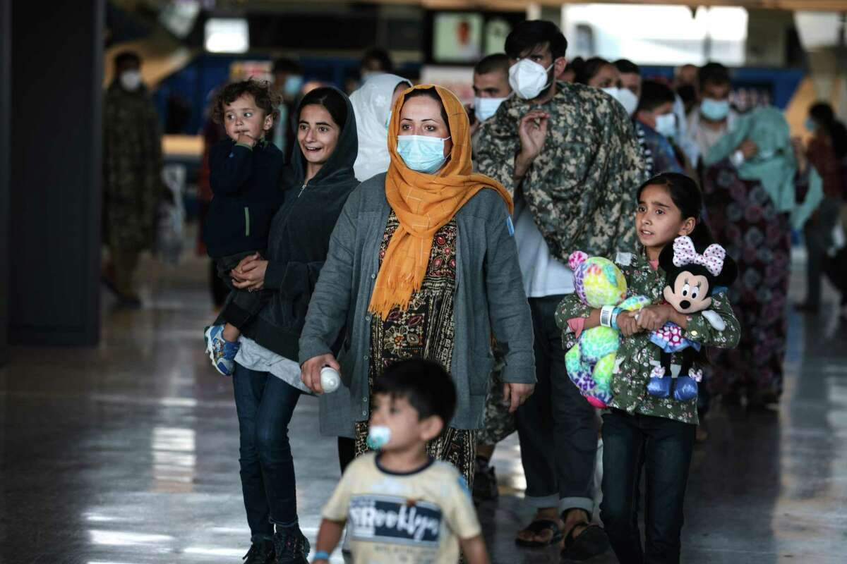 An Afghan family arrives Wednesday at Dulles International Airport in Virginia.