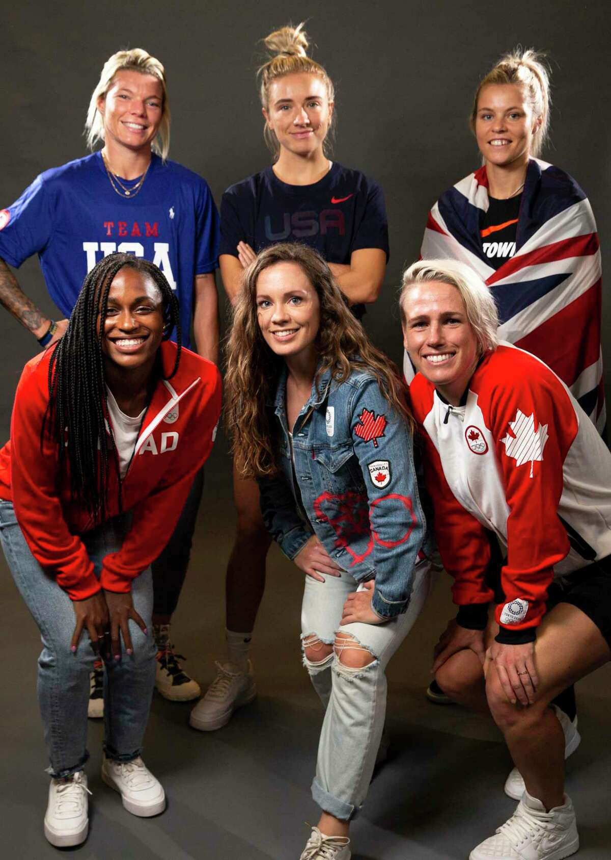 Houston Dash Olympians pose for a photograph Friday, Aug. 27, 2021, in Houston. Back from left: goalkeeper Jane Campbell, midfielder Kristie Mewis and forward Rachel Daly. Front from left: forward Nichelle Prince, defender Allysha Chapman and midfielder Sophie Schmidt.