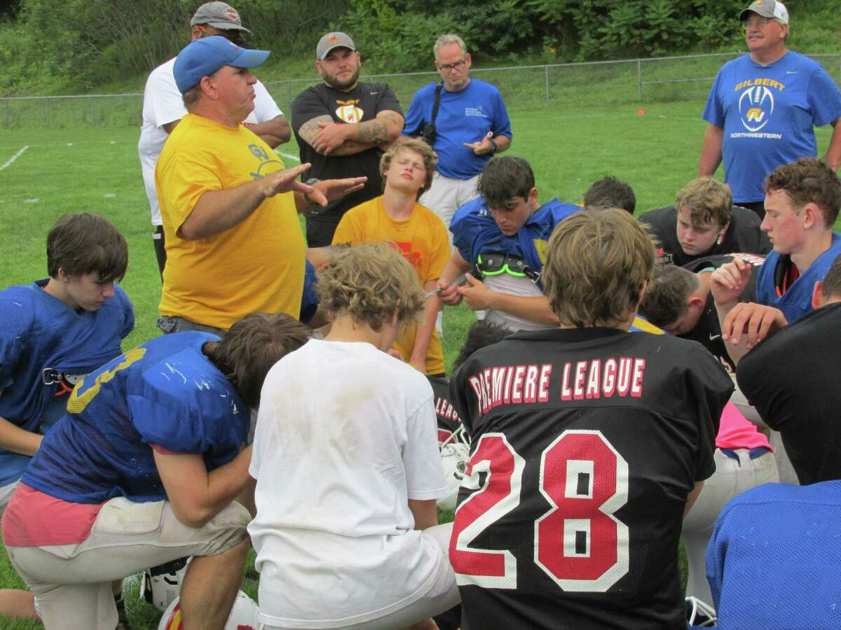 """Gilbert/Northwestern/Housatonic football coach Scott Salius challenges his team to """"let people know who we are"""" after a scrimmage with Cheney Tech Saturday morning at The Gilbert School's Van Why Field."""