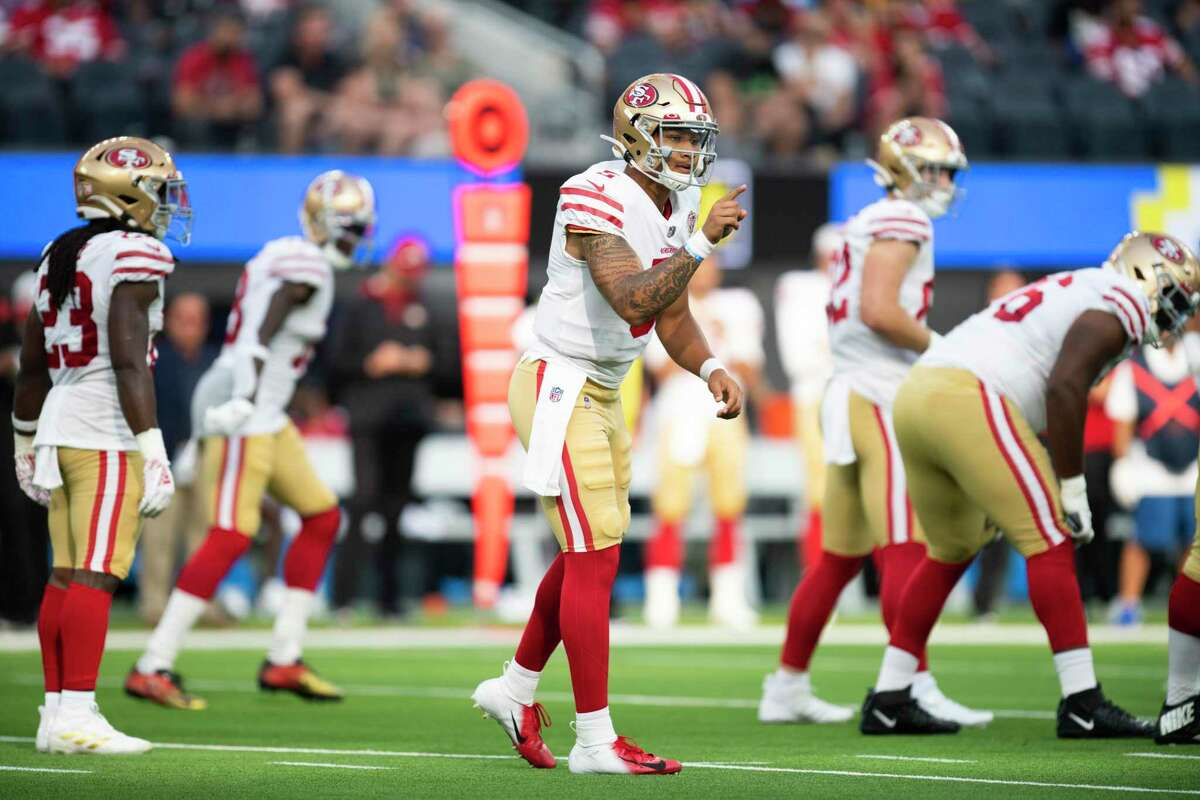 San Francisco 49ers quarterback Trey Lance (5) gives instructions to his teammates during an NFL preseason football game against the Los Angeles Chargers Sunday, Aug. 22, 2021, in Inglewood, Calif. (AP Photo/Kyusung Gong)