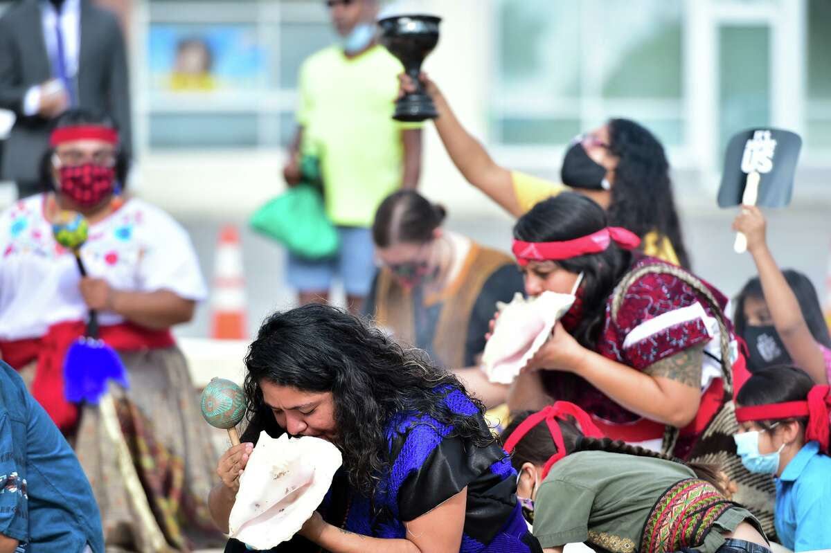 Members of the Kalpulli Ayolopaktzin intertribal group conduct the opening prayer service during the March on Voting Rights rally held Saturday at MLK Plaza.