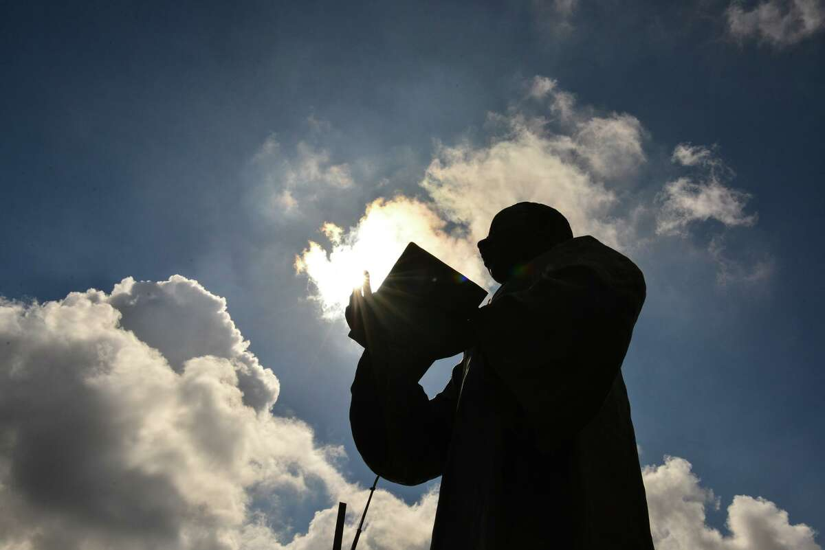 The sun highlights a statue of Dr. Martin Luther King Jr. during the rally Saturday at the Martin Luther King Plaza to demand voter rights protections.