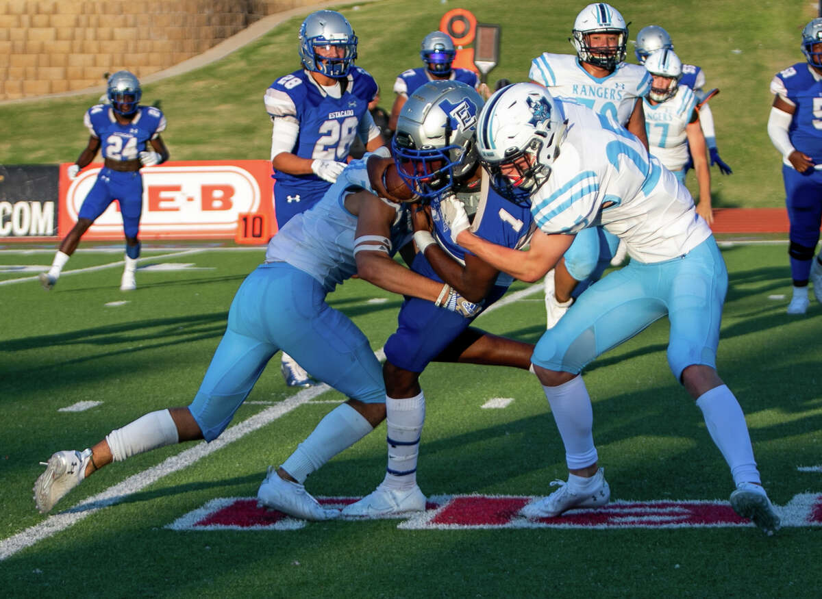 Lubbock Estacado's Colby Sims is tackled by Greenwood's Cash Mclntyre and an unidentified teammate on Friday, Aug. 27 at Lubbock's Lowrey Field.