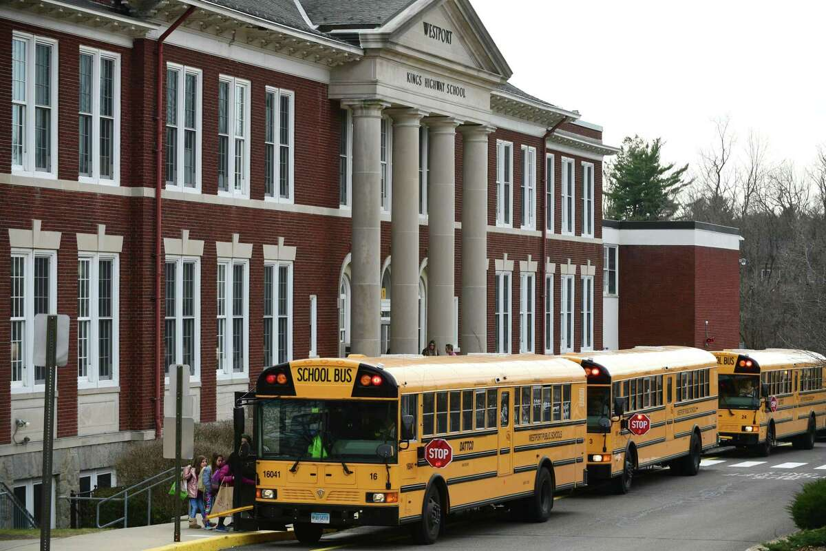 Students leave Kings Highway Elementary School on Wednesday, March 11, 2020, in response to the Covid-19 virus pandemic in Westport, Conn. The 2021-22 school year in Westport starts Aug. 31, 2021, and an array of COVID protection measures will be in place.