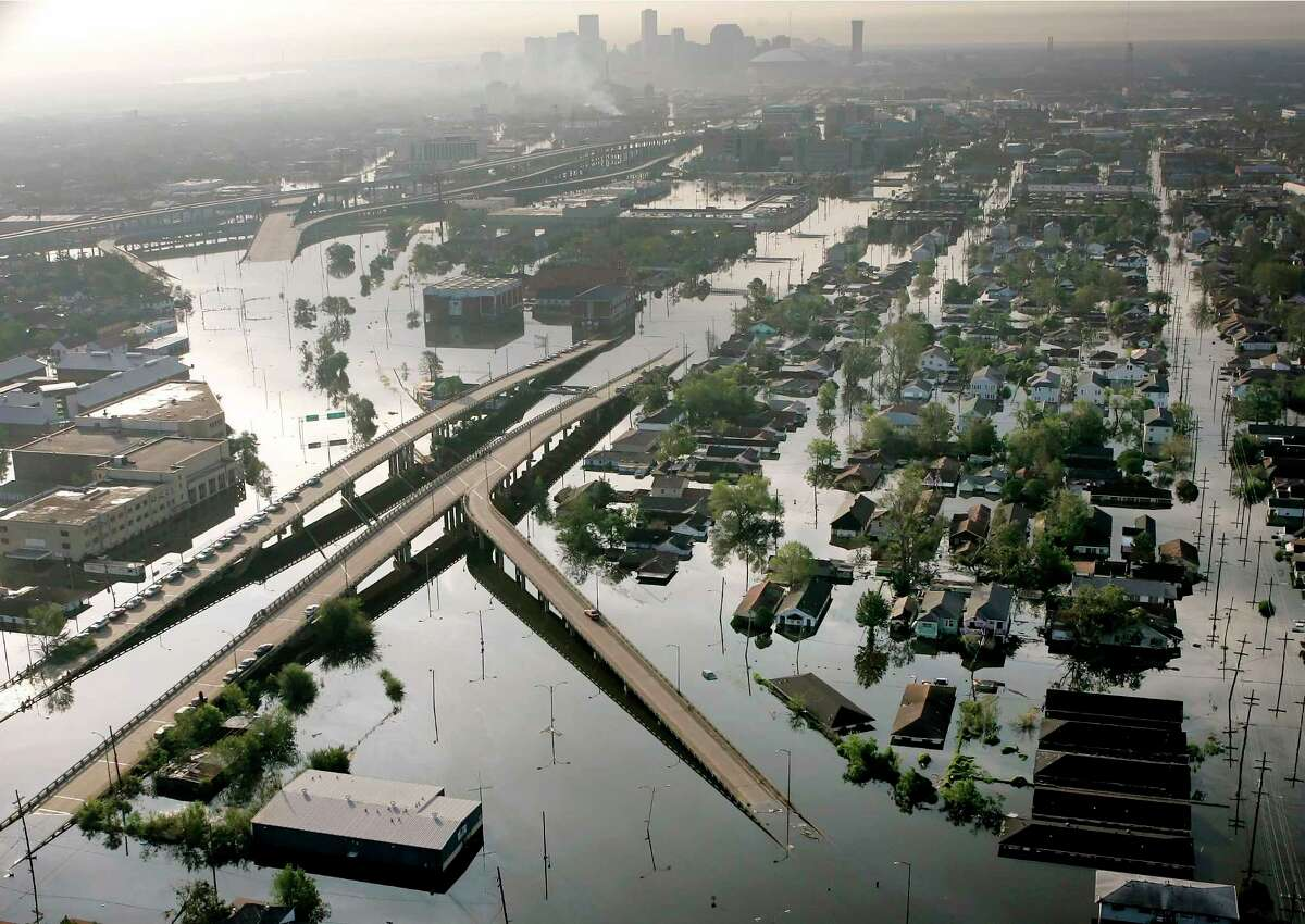 FILE - In this Aug. 30, 2005 file photo, Floodwaters from Hurricane Katrina fill the streets near downtown New Orleans. Hurricane Ida looks an awful lot like Hurricane Katrina, bearing down on the same part of Louisiana on the same calendar date. But hurricane experts say there are differences in the two storms 16 years apart that may prove key and may make Ida nastier in some ways but less dangerous in others.