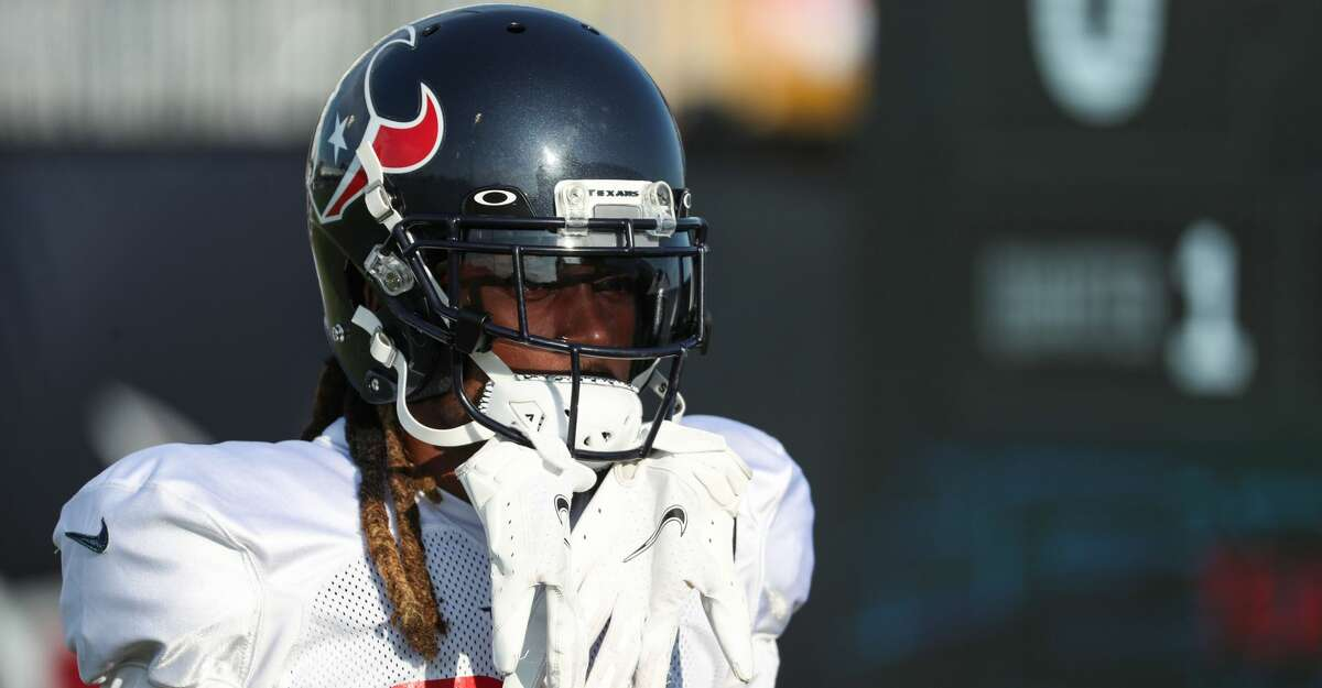 Houston Texans cornerback Bradley Roby walks onto the field during an NFL training camp football practice Saturday, Aug. 7, 2021, in Houston.