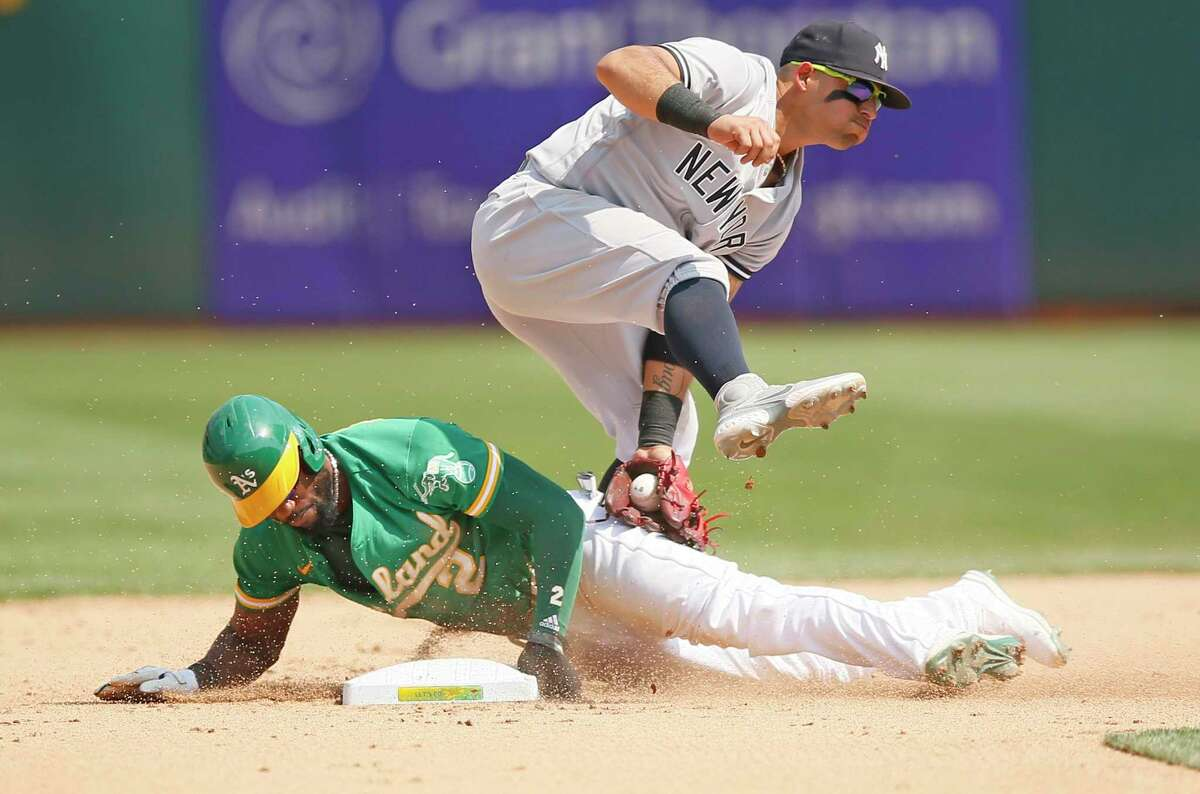 Oakland Athletics center fielder Starling Marte (2) steals second base in the fifth inning during an MLB game against the New York Yankees at RingCentral Coliseum on Saturday, Aug. 28, 2021, in Oakland, Calif.