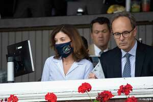 Gov. Kathy Hochul, left, and her husband Bill Hochul watch Essential Quality duels with Midnight Bourbon to win the Travers Stakes at Saratoga Race Course Saturday Aug. 28, 2021 in Saratoga Springs, N.Y.