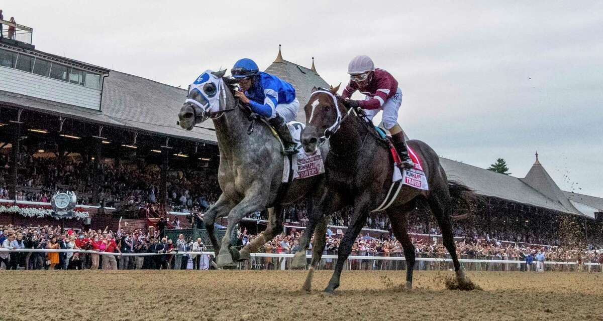 Essential Quality, with jockey Luis Saez, duels with Midnight Bourbon and jockey Luis Saez to win the 152nd Travers Stakes at Saratoga Race Course on Saturday, Aug. 28, 2021.