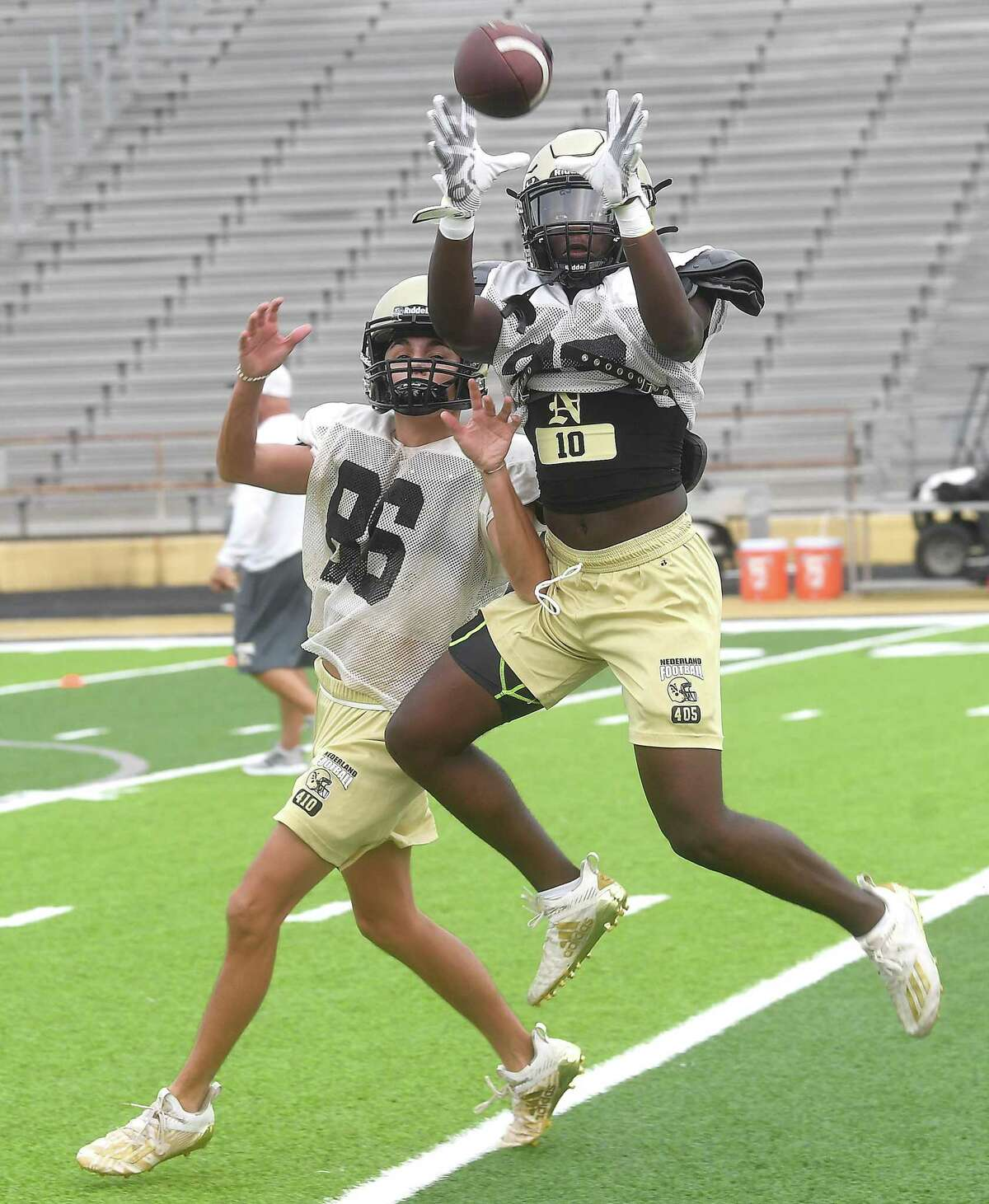 Nederland gets in early morning practice as they prep for the 2021 football season. Photo made Wednesday, August 4, 2021 Kim Brent/The Enterprise