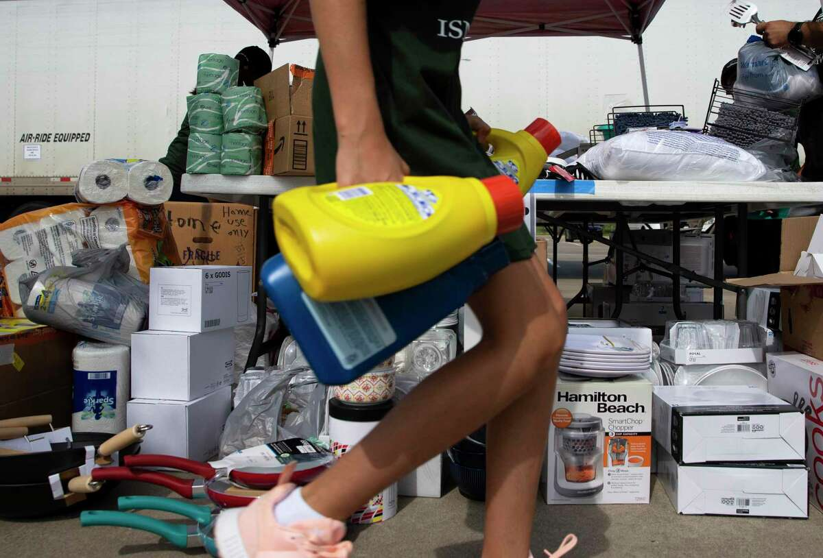 The Ismaili Jamatkhana and Center volunteers sorting donations during a supply drive for Afghan refugees and survivors of the earthquake in Haiti Saturday, Aug. 28, 2021, in Sugar Land.