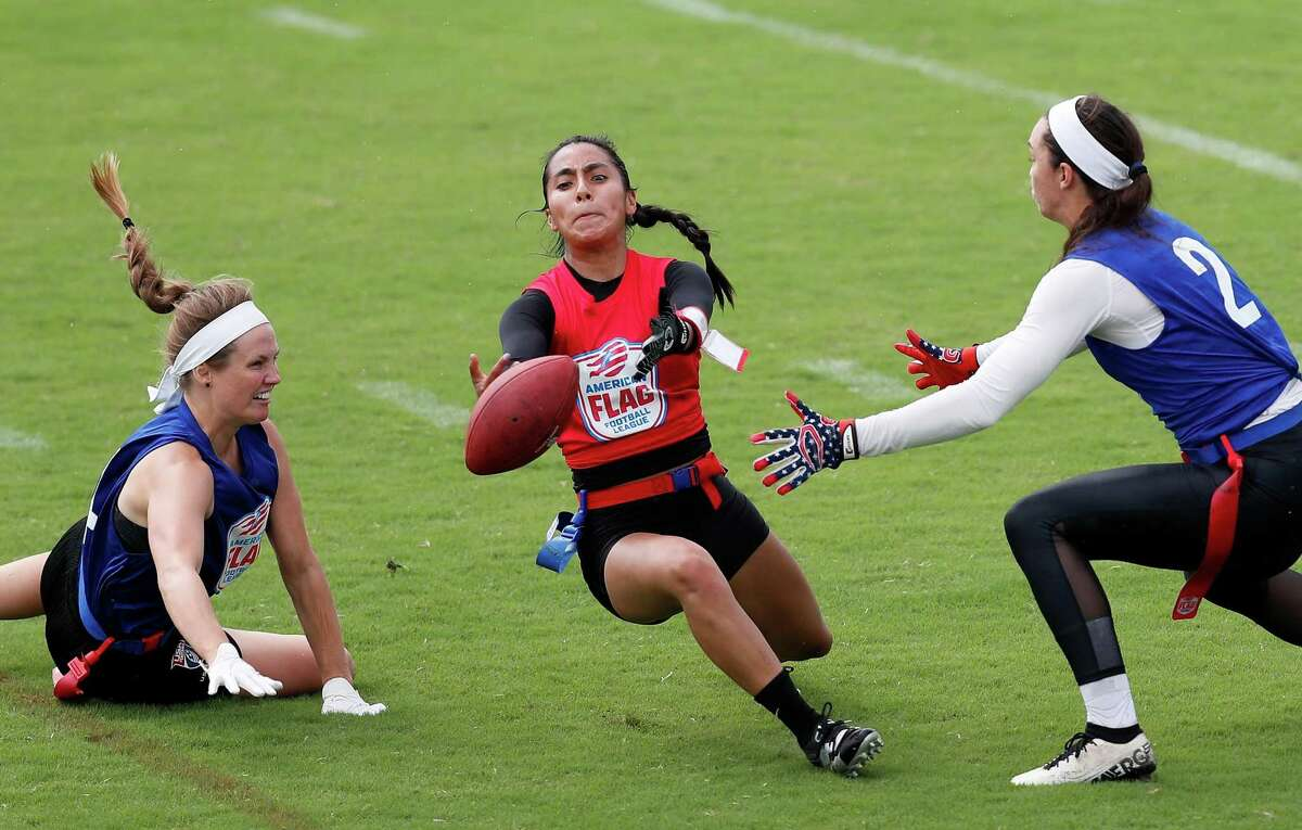"""The Academy Vanita """"V"""" Krouch (4) and Mariah Gearheart (2) defend a pass intended for She-Blitz Diana Flores (99) during the American Flag Football League championship game between The Academy and She-Blitz at AVEVA Stadium in Houston, TX on Saturday, August 28, 2021. The Academy defeated She-Blitz 26-0."""