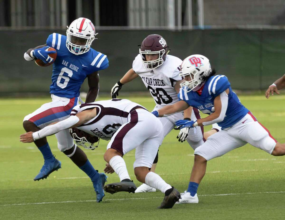 Oak Ridge wide receiver Jahron Jonas (6) is brought down by Clear Creek defense during the first quarter of a non-district football game at Woodforest Bank Stadium, Saturday, Aug. 28, 2021 in Shenandoah, Texas.
