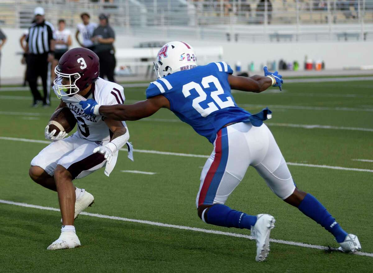 Clear Creek running back Jeremiah Crum (3) is under pressure by Oak Ridge defensive back Jordan Holmes (22) as he looks for an opening to advance with the ball during the first quarter of a non-district football game at Woodforest Bank Stadium, Saturday, Aug. 28, 2021 in Shenandoah, Texas.