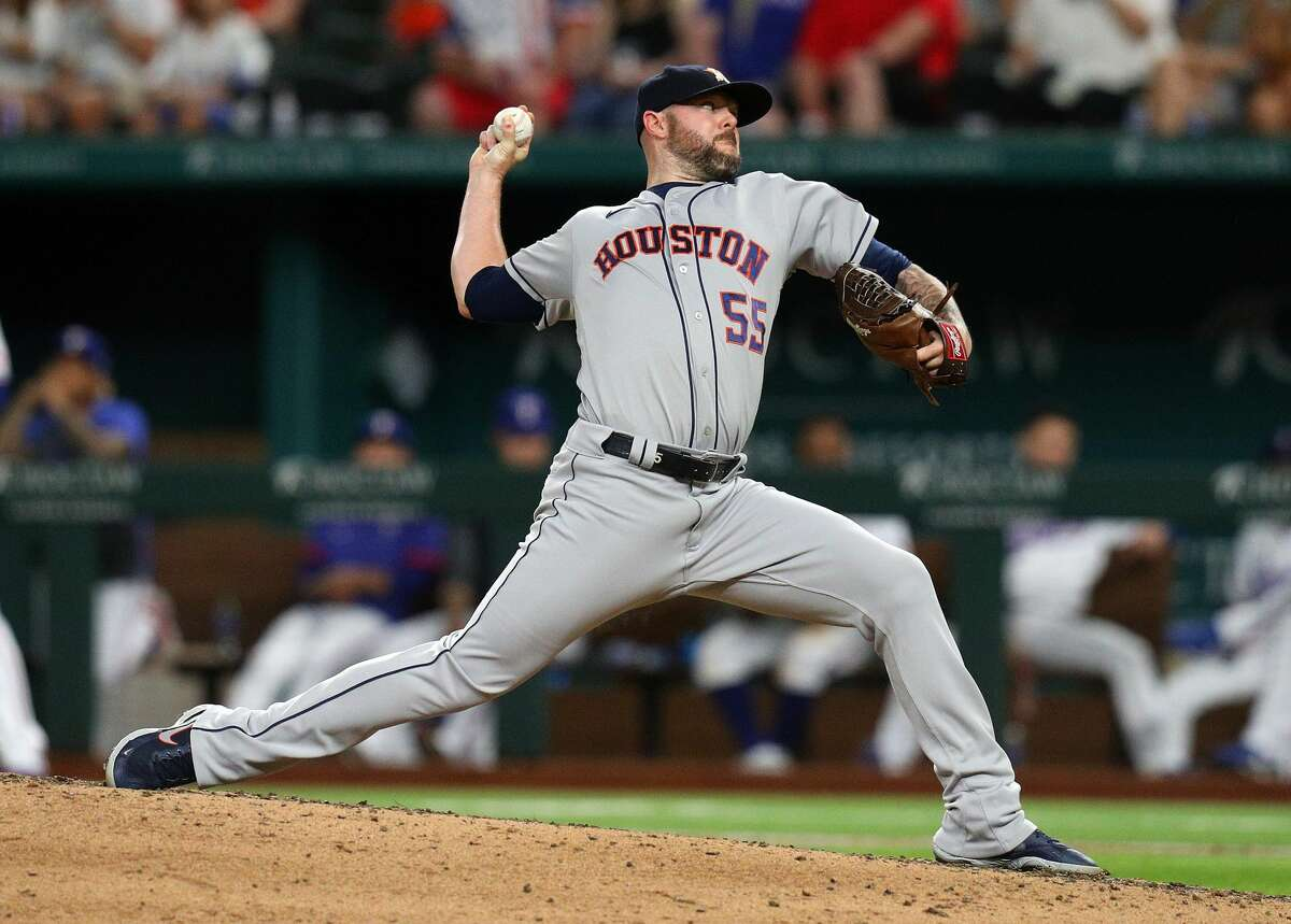 ARLINGTON, TEXAS - AUGUST 28: Ryan Pressly #55 of the Houston Astros pitches in the ninth inning against the Texas Rangers at Globe Life Field on August 28, 2021 in Arlington, Texas. (Photo by Richard Rodriguez/Getty Images)