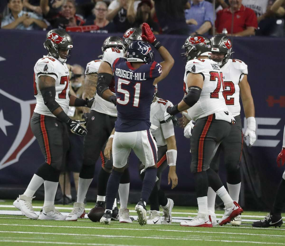 Houston Texans linebacker Kamu Grugier-Hill (51) signals a safety during the first half of an NFL pre-season football game at NRG Stadium, Saturday, August 28, 2021, in Houston.