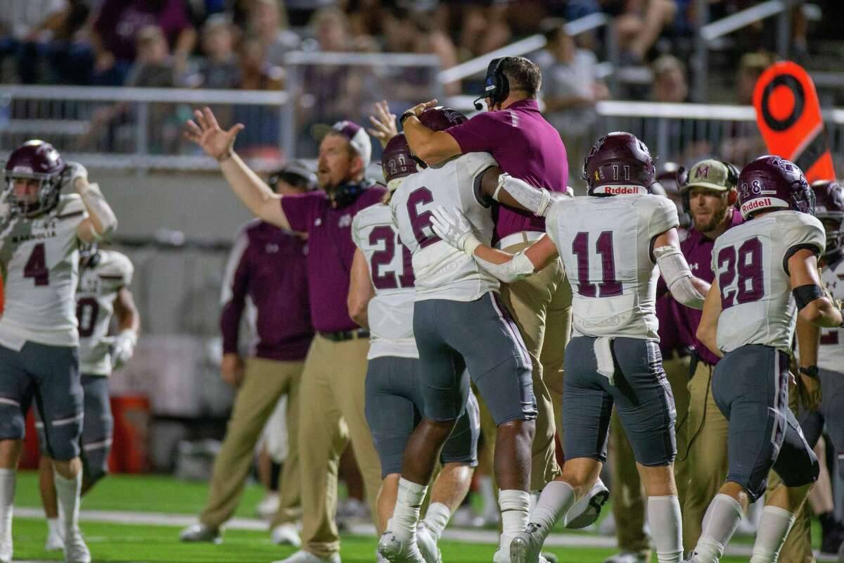 Magnolia Bulldogs LB Quentin Lucas (6) celebrates with a coach during second half of action between Tompkins Falcons vs. Magnolia Bulldogs during a high school football game at the Legacy Stadium, Saturday, August 28, 2021, in Katy. Tompskins Falcons defeated Magnolia Bulldogs 18-6. (Juan DeLeon/Contributor)
