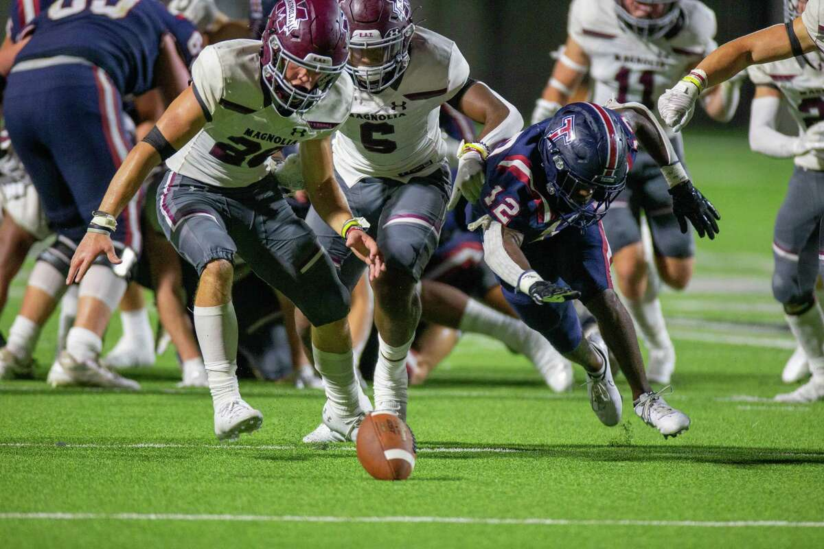 Tompkins Falcons RB Coliin Marshall (12) fumbles the football battles Magnolia Bulldogs LB Quentin Lucas (6) and DB John Alexander (28) during second half of action between Tompkins Falcons vs. Magnolia Bulldogs during a high school football game at the Legacy Stadium, Saturday, August 28, 2021, in Katy. Tompskins Falcons defeated Magnolia Bulldogs 18-6. (Juan DeLeon/Contributor)
