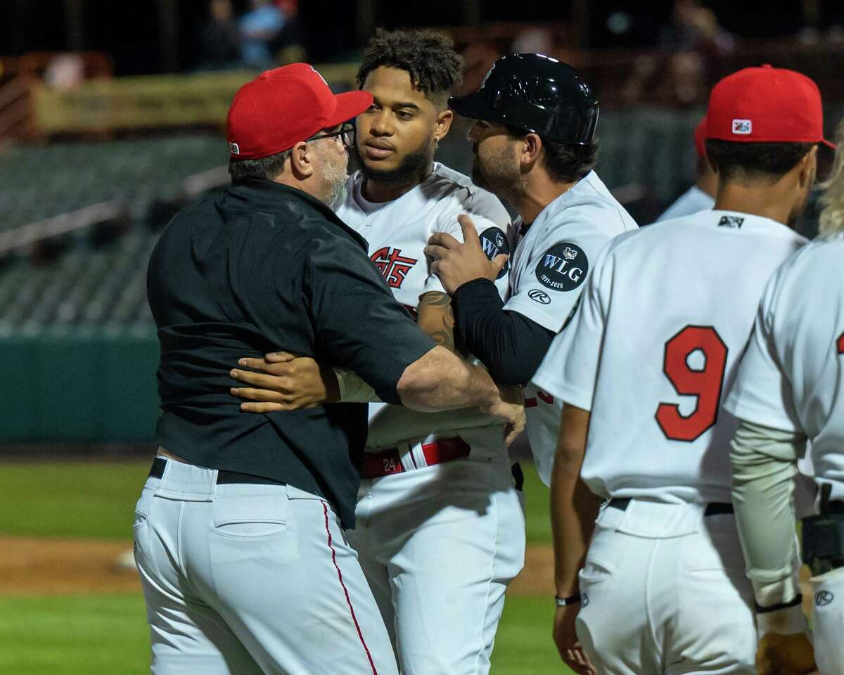 Tri-City ValleyCats manager Pete Incaviglia is held back after the benches cleared during a game against the Sussex County Miners at the Joseph L. Bruno Stadium on the Hudson Valley Community College campus in Troy, NY, on Saturday, Aug. 28, 2021.