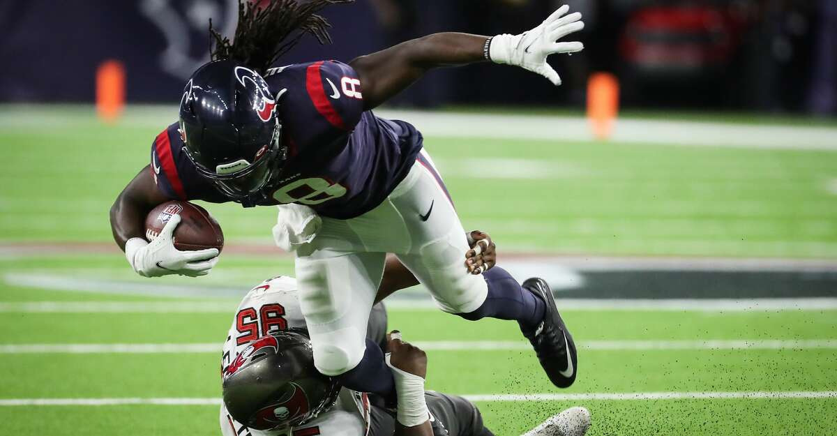 Houston Texans running back Buddy Howell (8) is stopped behind the line of scrimmage by Tampa Bay Buccaneers defensive tackle Jeremiah Ledbetter (95) during the second half of an NFL football game Saturday, Aug. 28, 2021, in Houston.