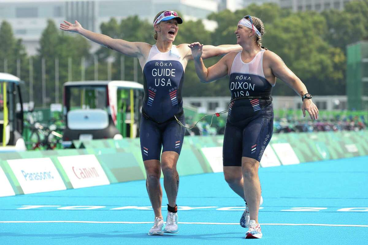 TOKYO, JAPAN - AUGUST 28: Amy Dixon and guide Kirsten Sass of Team United States celebrate after finishing the women's PTVI Triathlon on day 4 of the Tokyo 2020 Paralympic Games at Odaiba Marine Park on August 28, 2021 in Tokyo, Japan. (Photo by Lintao Zhang/Getty Images)