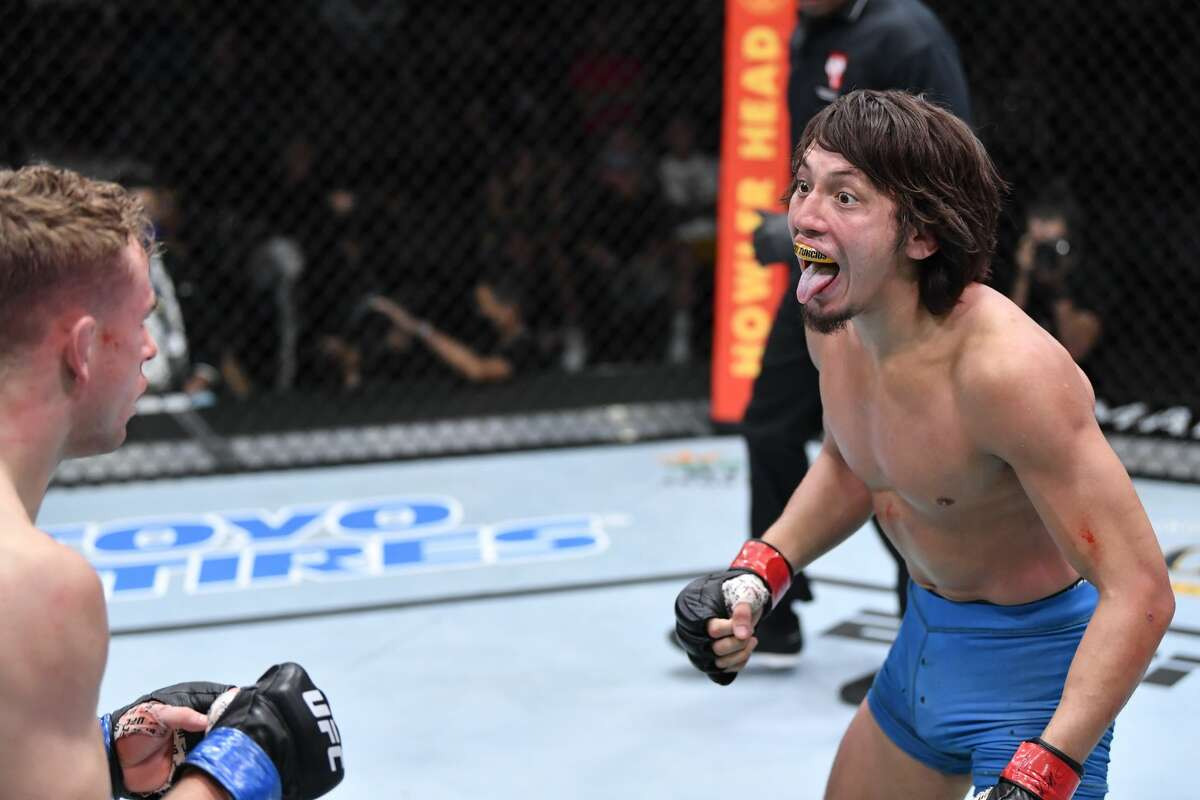 Ricky Turcios taunts Brady Hiestand in a bantamweight fight during the UFC Fight Night event at UFC APEX on August 28, 2021 in Las Vegas, Nevada.
