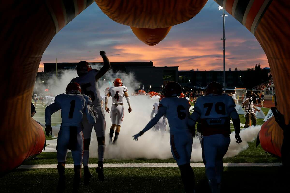 The Bridgeland Bears run through the tunnel to take the field during the first half of the high school football game between the Bridgeland Bears and the Klein Cain Hurricanes at Klein Memorial Stadium in Spring, TX on Saturday, August 28, 2021.