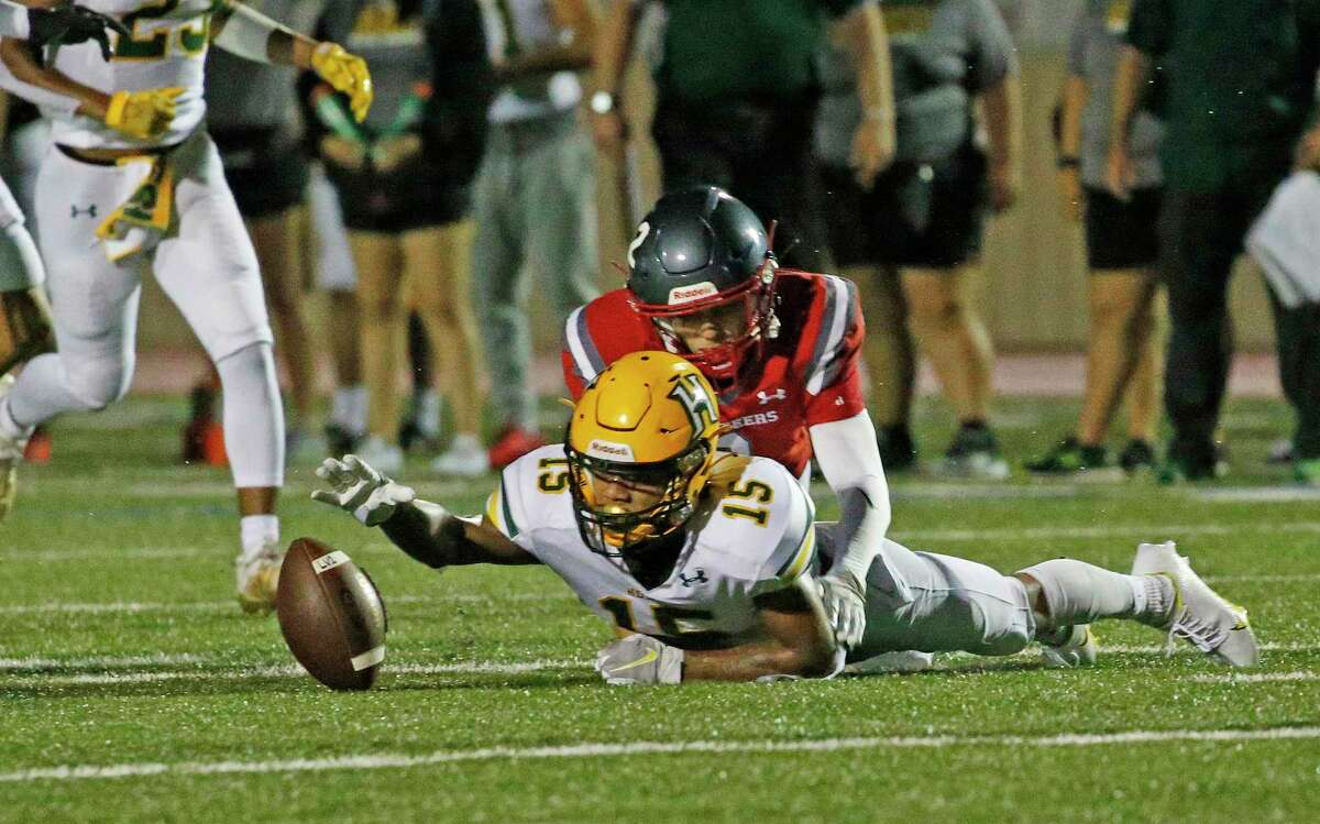 Holmes Ernie Solis (15) recovers a fumble against Lee on Saturday, Aug. 28, 2021 at Comalander Stadium.
