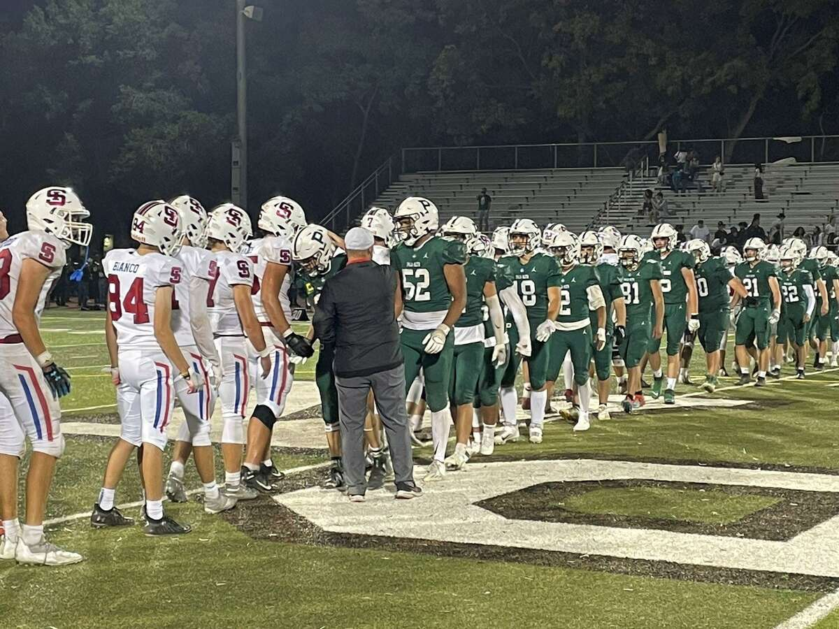Palo Alto players, in green, shake hands with St. Ignatius players after the game in Palo Alto on Friday night.