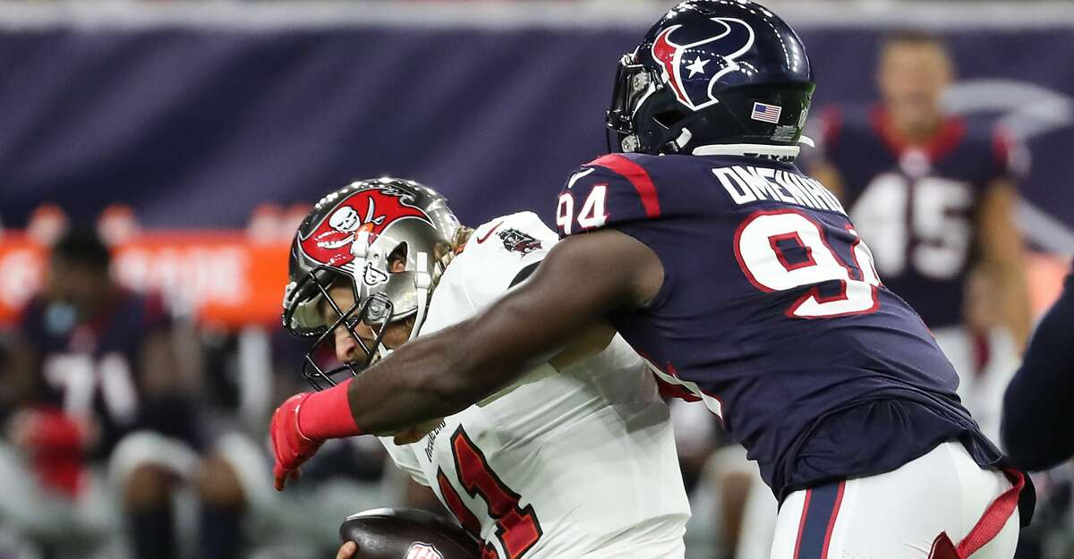 Houston Texans defensive end Charles Omenihu (94) sacks Tampa Bay Buccaneers quarterback Blaine Gabbert (11) during the first half of an NFL football game Saturday, Aug. 28, 2021, in Houston.