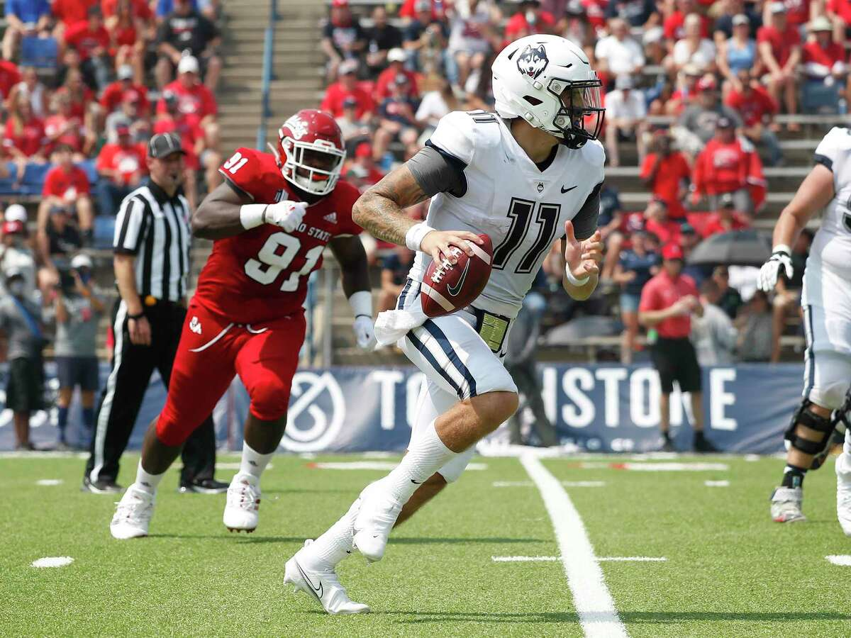 UConn's Jack Zergiotis (11) looks fir running room as Fresno State's Matt Lawson gives chase during the first half Saturday in Fresno, Calif.