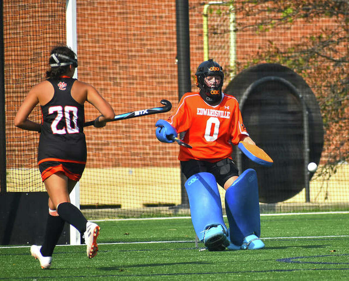 Edwardsville goalie Taylor Mollett makes one of her 10 saves in the game during the first quarter against John Burroughs on Friday in St. Louis.